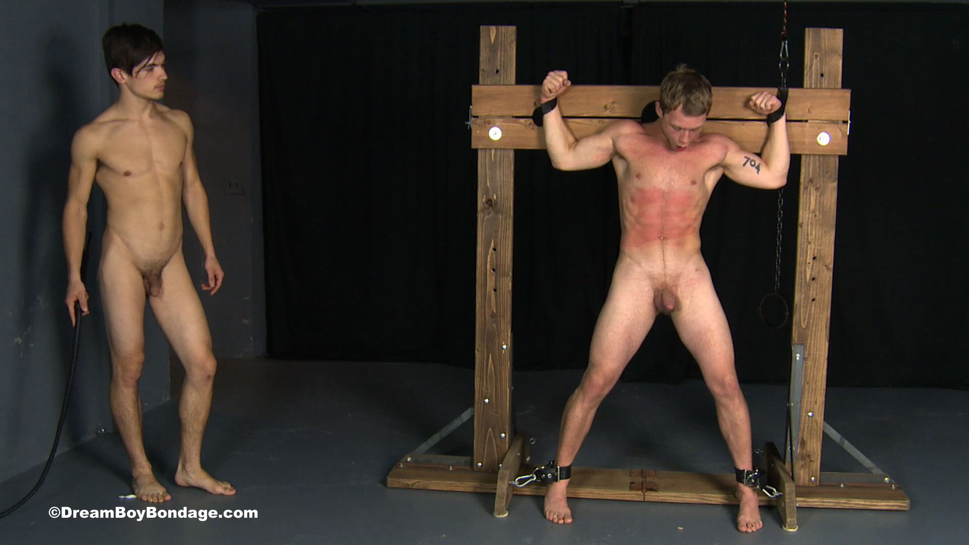 naked boy cross bondage